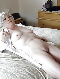 Experienced lass is posing seminaked on pictures