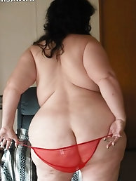 Plumper granny Wearing red sparkle plunge shoes and red see through panties
