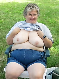 Shapely old milf is showing off her breasts