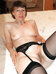 Busty mature damsel in her solo play