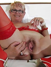 Mature cougar is touching herself